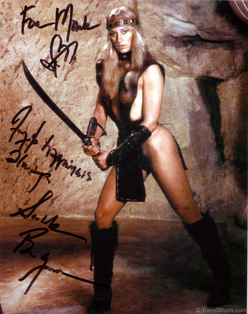 A nice photo Of Sandahl bergman in  pit fighter outfit Sandahl-bergman-signed-photograph