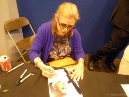 Carrie Fisher signing autographs at London Film and Comic Con 2014 06